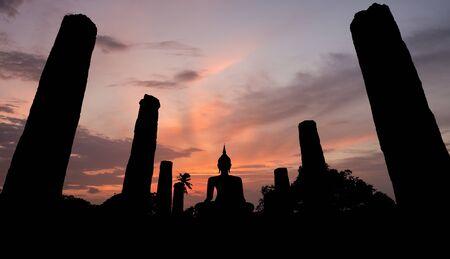 Silhouette of Ancient buddha statue. Sukhothai Historical Park, Sukhothai Province, Thailand