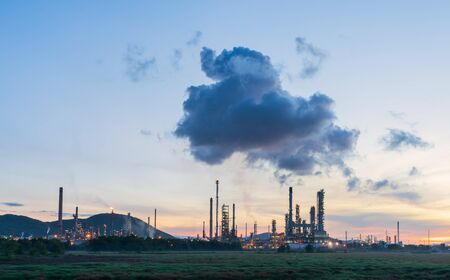 Oil refinery with beautiful sky at sunset. Energy power station. Stock Photo