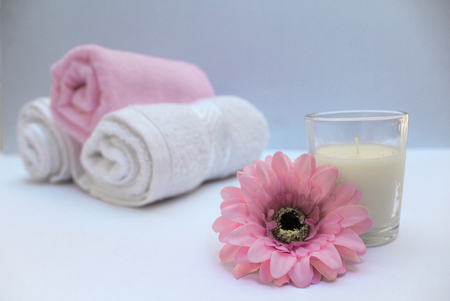 Flower and candle towels for relaxing massage