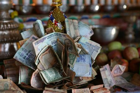 Buddhist altar in India with money donations. Reklamní fotografie