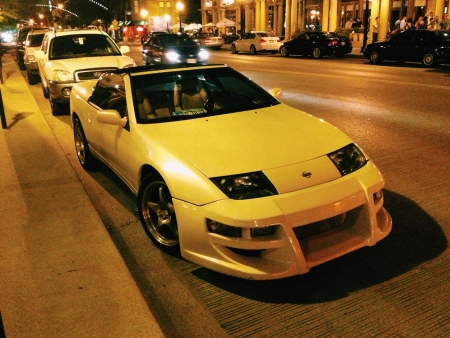 aftermarket: A very clean 300zx in Columbus Ohios short north district. Targa roof off cruising the night life. Nice aftermarket front  and back kit and a nice stance. All around clean ride Stock Photo