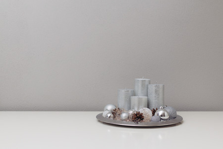 candels and christmas tree balls decorated in a silver plate stock photo 71726121 - Silver Plated Christmas Tree Decorations