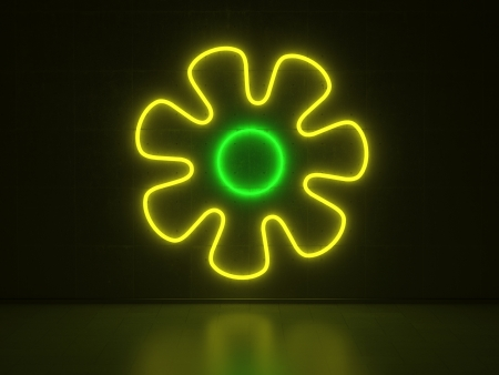 A green and yellow Neon Sign in Form of a Flower on a Wall of Concrete photo