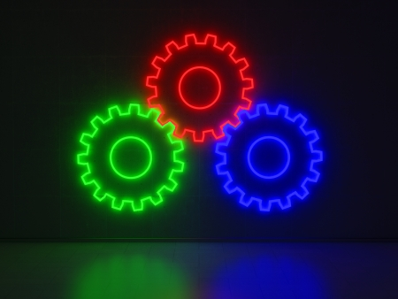 A blue, red and green Neon Sign in Form of combined Gears Cogwheels on a Wall of Concrete photo