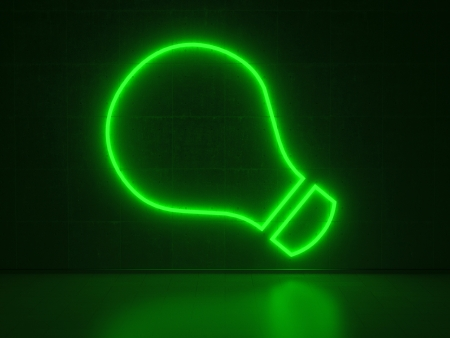 A green Neon Sign in Form of a Light Bulb on a Wall of Concrete photo