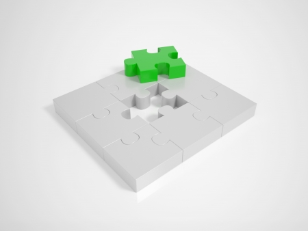 A green Piece completing a Puzzle on a bright Background photo