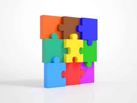 Multicolored Pieces of a Puzzle matching together and build up a Wall Stock Photo