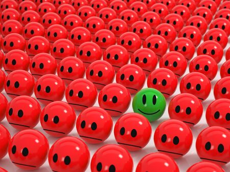 Red angry Spheres in a grid a green smiling Sphere stands out photo