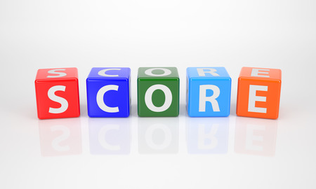 The Word Score out of multicolored Letter Dices photo
