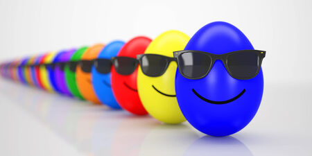 Group of colorful smiling Easter Eggs with black Sunglasses in a Row photo