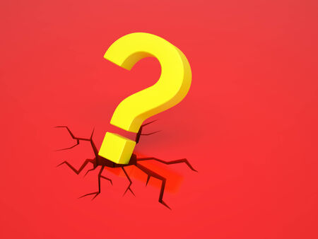 causes: A yellow question mark causes a crack on a red surface Stock Photo