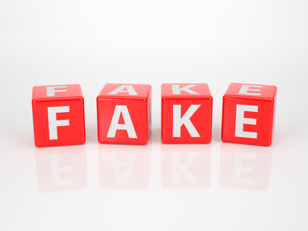 fraudster: The word fake out of red letter dices on white