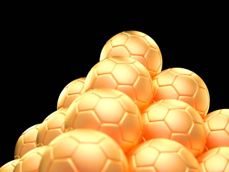 Close up of a pyramid made out of golden soccer balls on black background symbol for success and triumph photo