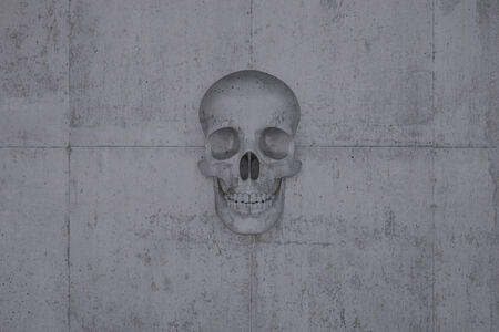 A skull on a wall of concrete symbol for doom and cataclysm photo