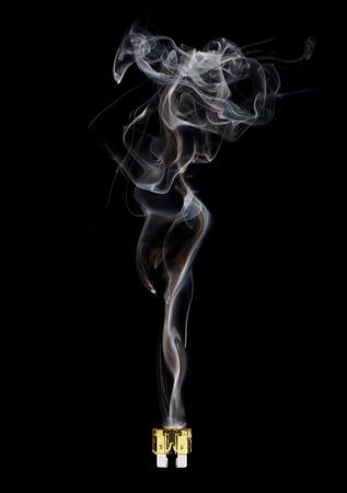 Blown fuse with feminine smoke isolated on black background