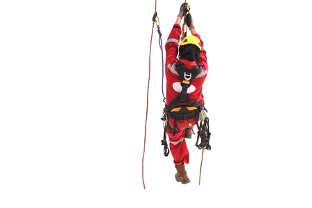 Rope access technician climbing with cable.