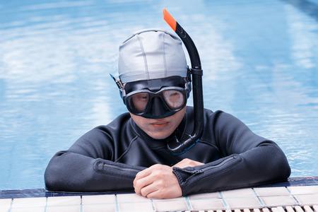 Free diving training on swimming pool