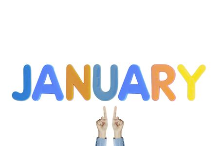 Hands point to wording JANUARY on white background