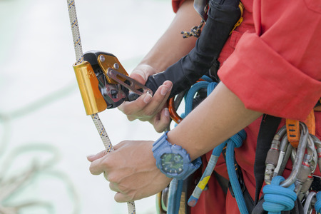 Inspector man wearing rope access equipment Фото со стока