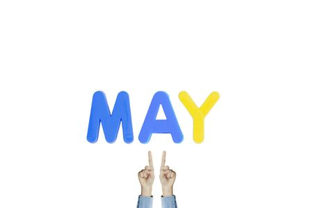 Hands point to wording MAY on white background