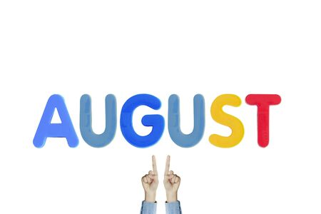 Hands point to wording AUGUST on white background