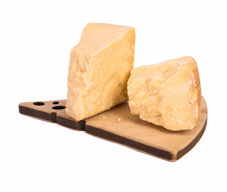 chees: Parmigiano reggiano chees with knife isolated on white