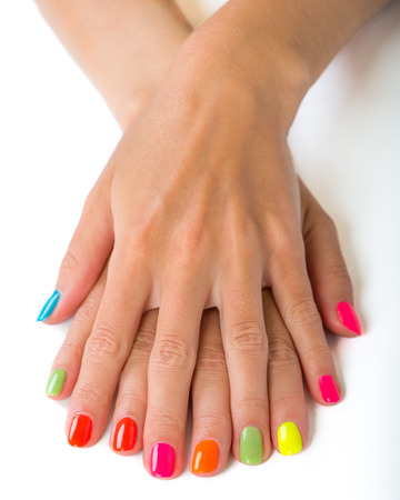 manicure: woman hands with bright manicure