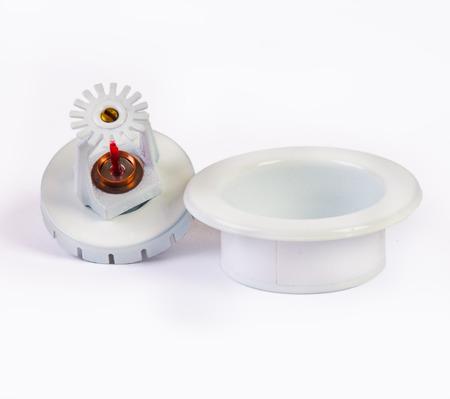 pendent: White pendent sprinkler nozzle with escutcheon on white