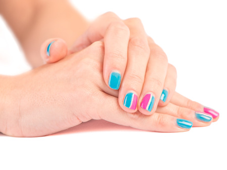 nailart: Bright manicure close up on white