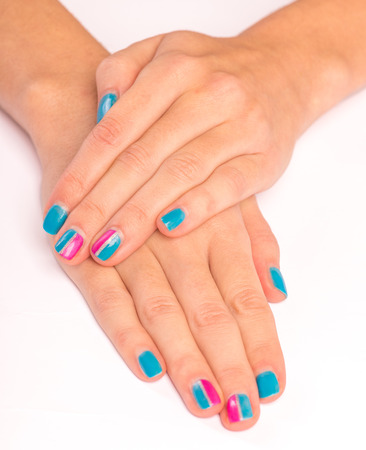 nailart: Bright manicure hands on white background