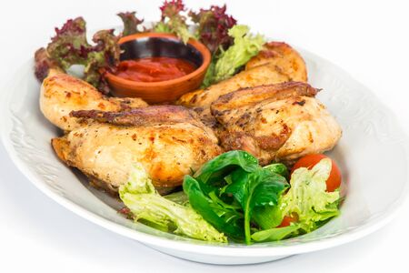 whole chicken: grilled whole chicken on the plate with salad and sauce