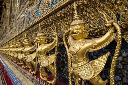 Golden garuda statue,Temple of emerald buddha,Bangkok,Thailand photo