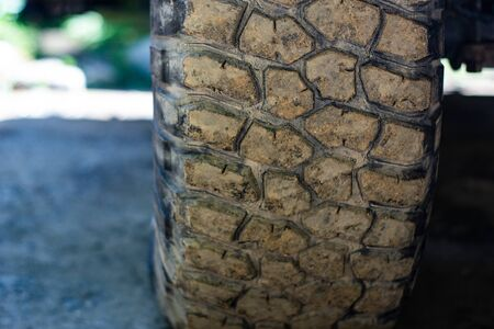 Close up of tread tire 4x4 off road, Texture of dirty wheel pickup car. Adventure on countryside