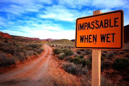 Impassable When Wet Sign Up Front of Arch Viewpoint at Arches National Park, Utah photo