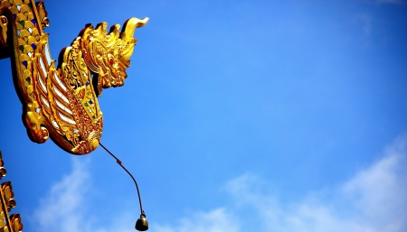 Nice Gold Dragon head at The Conner of The Temple, Chiang Mai, Thailand photo