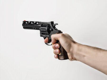 holdup: gun and hand