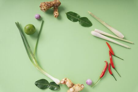 Top view - Spicy Tom Yum ingredients over green background. Thai food. Stock Photo