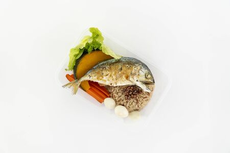 Top view of deep fried mackerel with rice and boiled vegetables in a box. Isolate in white. Stok Fotoğraf