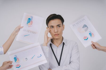 Asian thai businessman isolated over white background. Too much work. Over time working in office. Tired of working. Messy thing in busienss company. Work over due date.