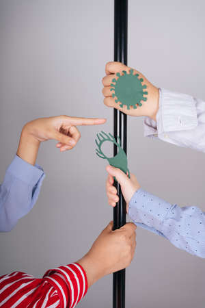 People hands grabbing a pole in a train isolate over white background. Coronavirus pandemic.