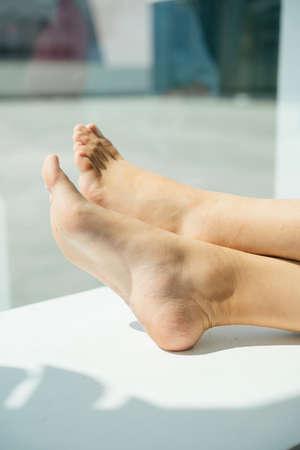 Beautiful barefoot of woman resting at home. Beautiful feet skin.