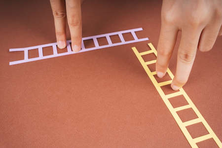 Two finger climbing paper ladder. Future career and job concept. Reklamní fotografie