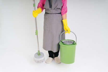 Maid woman with cleaning equipment tools. Mop stick and bucket.
