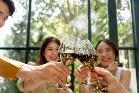 Group of young asian thai people enjoy drinking red wine toasting and celebrating. Stock fotó