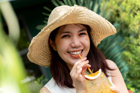 Asian thai woman wearing hat travel with luggage walking on the street outdoors. Imagens