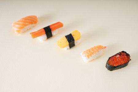 Japanese shushi set on white background. Salmon egg. Shirmp. Egg roll. Crap stick. Salmon.