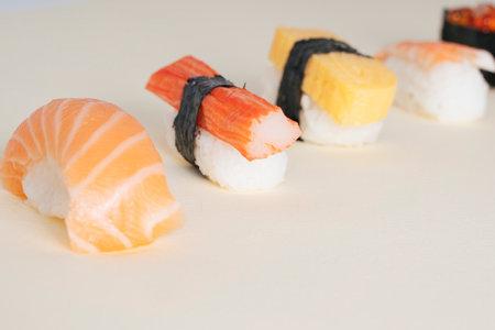 Japanese shushi set on white background. Salmon egg. Shirmp. Egg roll. Crap stick. Salmon. Foto de archivo