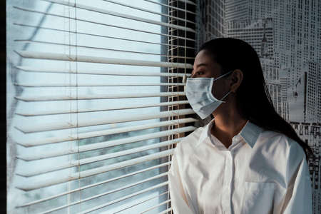 Black long hair woman wear a hygienic mask 'cause she get sick.