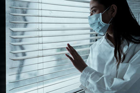 Black long hair woman get flu, she wear the hygienic mask even in the hospital, she wanna get out of the hospital.