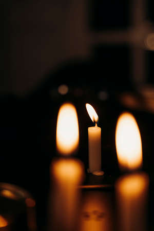 Candles light burning at night in the dark room.